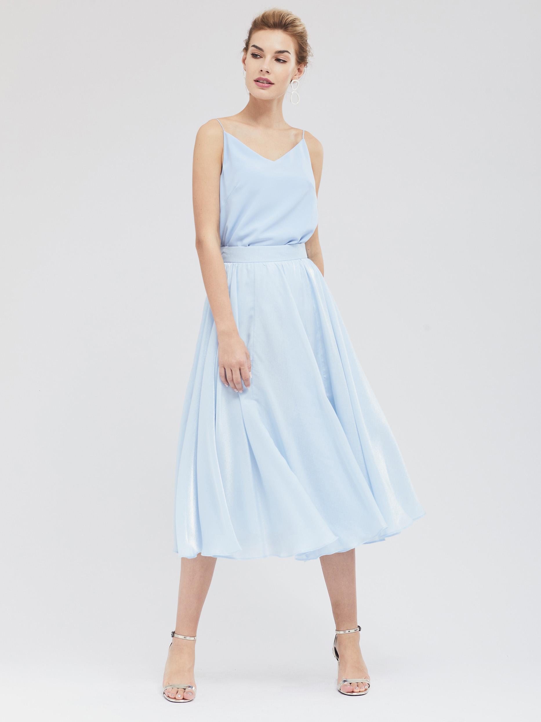 Расклешённая юбка из ткани с блеском фото